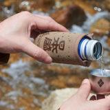 日本盛とmont-bellのオリジナルおちょこ付きクージーと生原酒ボトル缶セットが発売